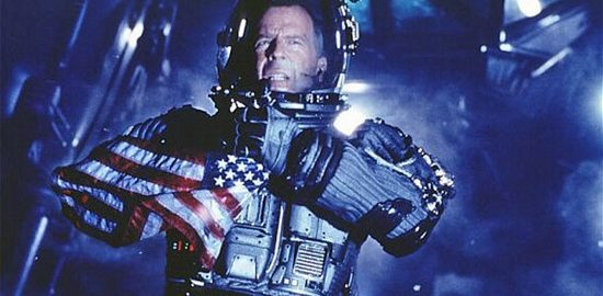 Bruce Willis in a spacesuit holding an American flag.