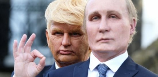 A Donald Trump impersonator stands behind and over the shoulder of a Vladimir Putin impersonator.